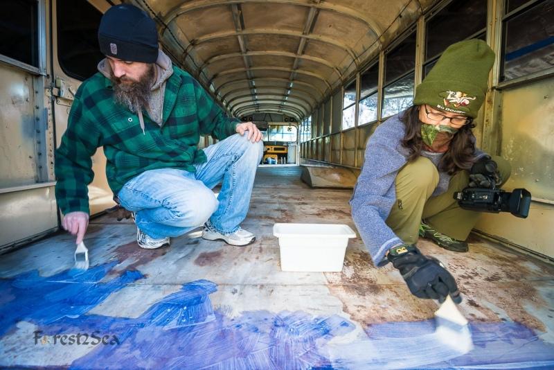 Scott & Carolita applying rust converter to Skoolie Woolie